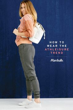 How to wear the athleisure trend! Start with the jogger pant, no workout required! Keep things comfy-chic in a blush pullover jacket. (Two textures are more fun than one!) Just add white tennis shoes and a drawstring backpack with perforated details. Visit Marshalls to style the athleisure look your way.