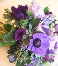 Purple anemone, purple lisianthus, purple muscari, silver foliage