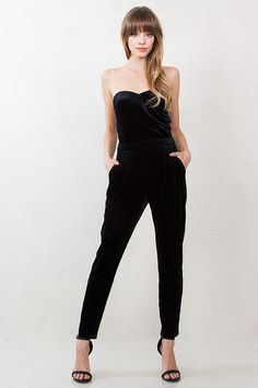 Ditch the dress this holiday and go for a black velvet jumpsuit with a sweetheart neckline. #streetstyle