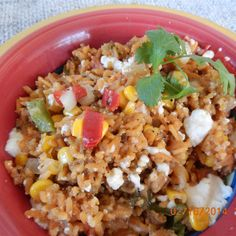 Rice is baked with three kinds of corn, bell peppers, onions, tomatoes, green chile peppers and Mexican-style cheese. Side Dish Recipes, Veggie Recipes, Mexican Food Recipes, Great Recipes, Vegetarian Recipes, Cooking Recipes, Favorite Recipes, Healthy Recipes, Rice Recipes