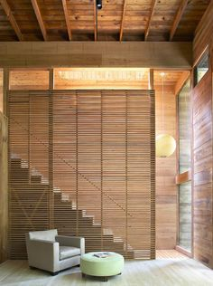Bates Masi, wood slatted wall in front of stairs