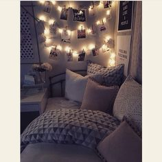 Another one with photos and fairy lights I also like the pillows and the way that the bed is in the corner.