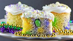 Cake and jelly shots combine to make this take on a Mardi Gras King Cake.