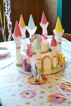 Also, the cake must have towers and ponies around it. I'm going to use plastic ponies and maybe make the towers with paper towel tubes and scrapbook paper