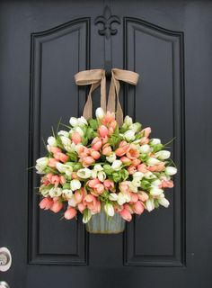 Fill a galvanized bucket with faux or fresh pink and white tulips for a classic, country-cottage look.