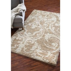 Shop Mohawk Home Wilkshire Apple Butter Biscuit Rectangular Cream Transitional Tufted Area Rug (Common: 5-ft x 8-ft; Actual: 60-in x 96-in) at Lowes.com