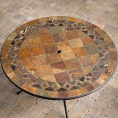 Circle mosaic border with square field tile fill. Feels more open than filling with concentric circles, which can kind of suck you right into the center