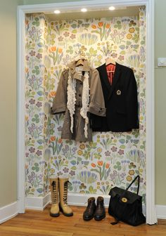 Display nook. Love that they turned a nook into a decorative 'closet' with some great wallpaper