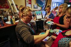 Amanda Happel started Cork N Canvas Iowa, a traveling painting party business, in January of 2014 after the art shop where she was working closed its doors.