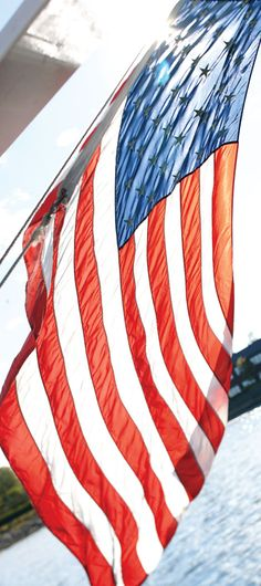 """Each day the flag, called the """"Colors,"""" is hoisted and lowered with fanfare-and who doesn't like to see the Stars and Stripes lovingly handled in such breathtaking surroundings?"""