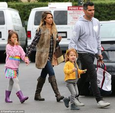 Jessica Alba (with a Louis Vuitton Christian Louboutin bag) with husband Cash Warren and their two daughters, Honor, six, and Haven, three in West Hollywood, California.  (January 11, 2015)
