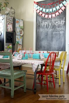 Love the GIANT chalkboard.  (We carry a large selection of colorful chippy paint chairs - kid + adult size! homepartieslife AT gmail DOT com)...different color chairs?  Same color?