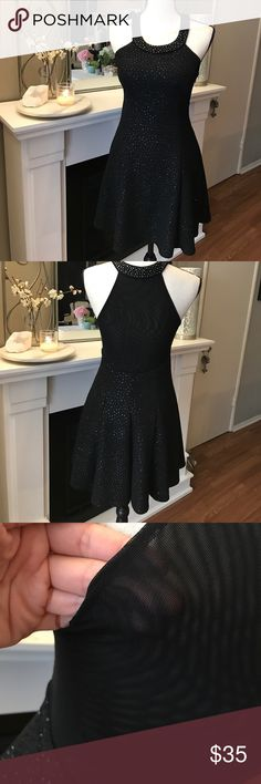 Beautiful sparkly Little black dress! Size small.  Has beaded neckline and sparkles throughout!  Gorgeous and VERY flattering on! Dresses