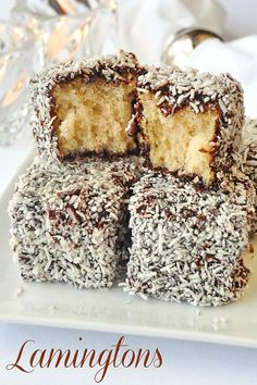 Chocolate Coconut Cake Squares a. Lamingtons, homemade white cake dipped in … Chocolate Coconut Cake Squares a. Lamingtons, homemade white cake dipped in a decadent chocolate syrup and then rolled in coconut. An Australian fave! Cupcakes, Cupcake Cakes, Decadent Chocolate, Chocolate Syrup, Chocolate Coconut Cakes, Dessert Chocolate, White Chocolate, Just Desserts, Delicious Desserts