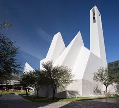 Traditional elements like a bell tower are reinterpreted as pointed protrusions in this sculptural church in Monterrey, designed by architecture studio Moneo Brock.