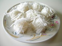 """(Husband Killers) - This is a Cambodian snack composed of glutinous rice flour, palm sugar and grated coconut. The story is....once there was a newly wed couple. One morning husband went to work and the wife decided to make a treat for her hubby. He quickly popped one in his mouth but it was still too hot and he ate too fast he started choking. However, he wanted look """"manly"""" in front  of his new wife so he acted like nothing happened and tried to swallow it down....sadly he didn't make it…"""