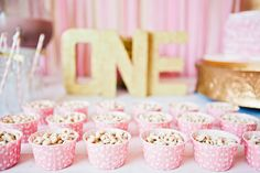 gold and pink. Love the little individual cups. Could put any treat in there. Ice cream bar....