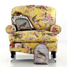 Birdie needs this now Cage shaped pillows and lemon yellow floral w/birds, smelling salts please