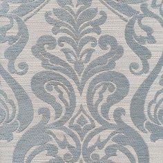 This is a blue and natural woven chenille floral upholstery fabric by Barrow Merrimac Fabric, suitable for any decor in the home or office.  Perfect for pillows, cushions and furniture.