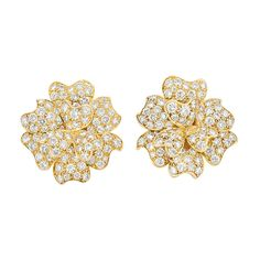 Pair of Gold and Diamond Flower Earrings, Van Cleef & Arpels   18 kt., the flowers composed of overlapping petals pave-set with 178 round diamonds approximately 5.20 cts., signed Van Cleef & Arpels, N.Y. 44692, approximately 9.6 dwts.