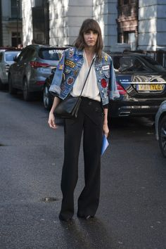 #LFW White shirt, black trousers and patched denim jacket - classic plus punk. Street Style at London Fashion Week, Ready-to-Wear Spring 2014. Photo: IMAXtree