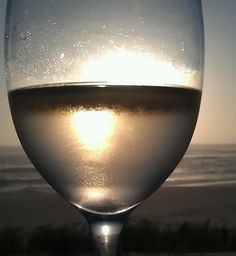 A glass of our unoaked Chardonnay - sand, sun and the southern Atlantic Ocean.