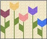 pieced tulip block would make a cute throw pillow for spring.... OR a nice row for a row robin