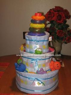 Homemade Cool Diaper Cake with Receiving Blankets... This website is the Pinterest of diaper cake ideas