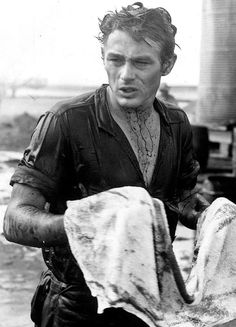 "James Dean cleans up after filming the oil scene in ""Giant"", 1956"