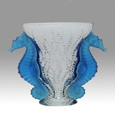 A stunning glass vase entitled 'Poseidon' decorated with rising bubbles and two seahorses applied. A fine clear, frosted & coloured glass vase signed