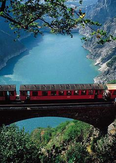 Train in Grenoble, France crossing a bridge.  Photo by When Nature Calls.