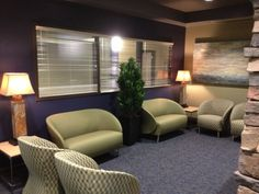"""In this Waiting Area we used the Uttermost  """"Slate Tall Table"""" (926308) lamps and """"Free Fall"""" (32229) art.  Also in this space, we used the """"Sterling Trees"""" art (35105), not shown in this photo."""