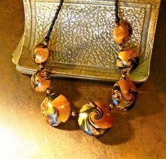 Lentil swirl necklace, sold...similar item:  http://www.stringingalong.com/swirls/terra