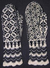 Knitted two-color mittens in the Selbu style.  From the Vesterheim Norwegian-American Museum collections.