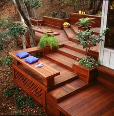 Redwood deck- I wonder if we could stain our current deck this color. Would go well with the house!