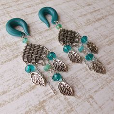 Hey, I found this really awesome Etsy listing at http://www.etsy.com/listing/125813082/island-leaf-drop-gauged-earrings