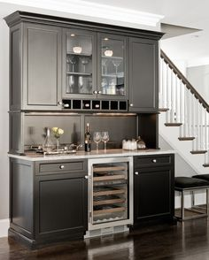 Counter-height workspace, drawers, kind of cool wine rack feature
