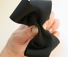 How to make a hair bow. A quick and easy craft with picture tutorial for making your own hair bows. These make great gifts too.