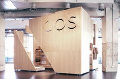 Cos Pop-up store, Milan - wood box designed to pull apart to allow circulation through the space