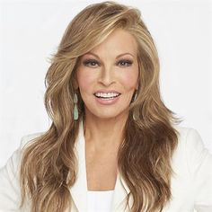 Miles of Style #Wig by Raquel Welch Long layers fall to mid-back to create this full, flowing silhouette.
