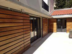 Volet persiennes bois coulissants à Villefranche sur Mer - Fabrication de volet en bois persiennes à Marseille - Boiseries Provencales