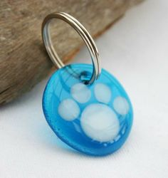 Cool, funky paw print keyring in turquoise. Available in a huge range of colours. £5 each. Copyright Anne Smith Glass Designs.
