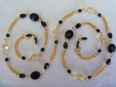Black glass beads and pale yellow crystal handcrafted chain eye or sunwear holder by arepaki.etsy.com