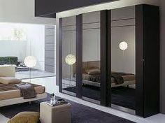 Contemporary bedroom with mirrored wardrobe.