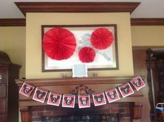 Mickey Mouse party banner. Free printable I found through Pinterest and made the red paper decorations out of folded tissue paper.