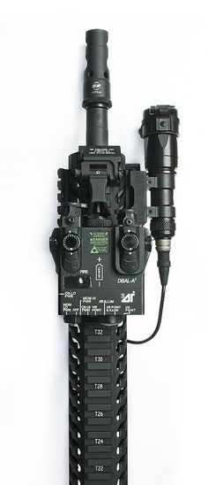 Laser Devices DBAL-A2 on a Samson Evolution with Troy Folding Sight, Surefire MB556K, Sabre 14.5'' 5.56mm Barrel and Surefire Scoutlight. LaRue QD Mount.