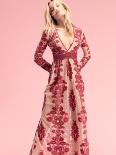 this romantic Maxi Dress from free people features beautiful floral embroidering, a plunging v-neck and a crocheted waistband.