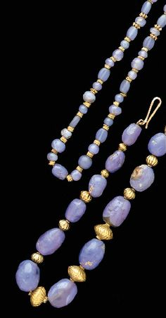 TWO ROMAN OR PARTHIAN BLUE CHALCEDONY AND GOLD NECKLACES CIRCA 1ST-2ND CENTURY A.D.