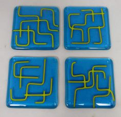 These contemporary glass coasters feature a gorgeous Caribbean turquoise with lime green pattern detail. These coasters are one of a kind and they