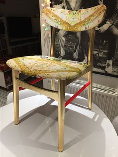 'Make it fabulous' chair commission. Gilded, highlighted with neon red paint and covered with 'Elixir' fabric/paper.